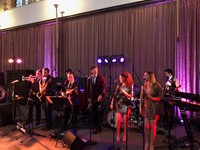 Live swing and soul musicians performing at a wedding reception at Eltham Palace, London
