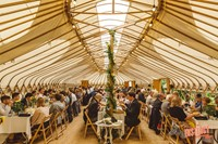 Dinner at a Buckinghamshire yurt wedding reception, photo by Potters Instinct Photography