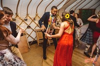 The party with live music from swing band Down for the Count at a Buckinghamshire yurt wedding reception, photo by Potters Instinct Photography