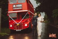 A London Routemaster bus with bride and groom at a yurt wedding reception in Buckinghamshire, photo by Potters Instinct Photography