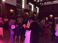 Live wedding band performing for bride and groom at reception at Selwyn College, Cambridge