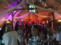 Live swing band performing at a wedding reception at Lains Barn, Oxfordshire