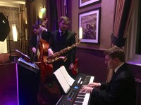 Live jazz trio performing at Berkshire corporate event