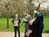 Instrumental jazz trio performing roaming acoustic walkabout music for a London wedding drinks reception