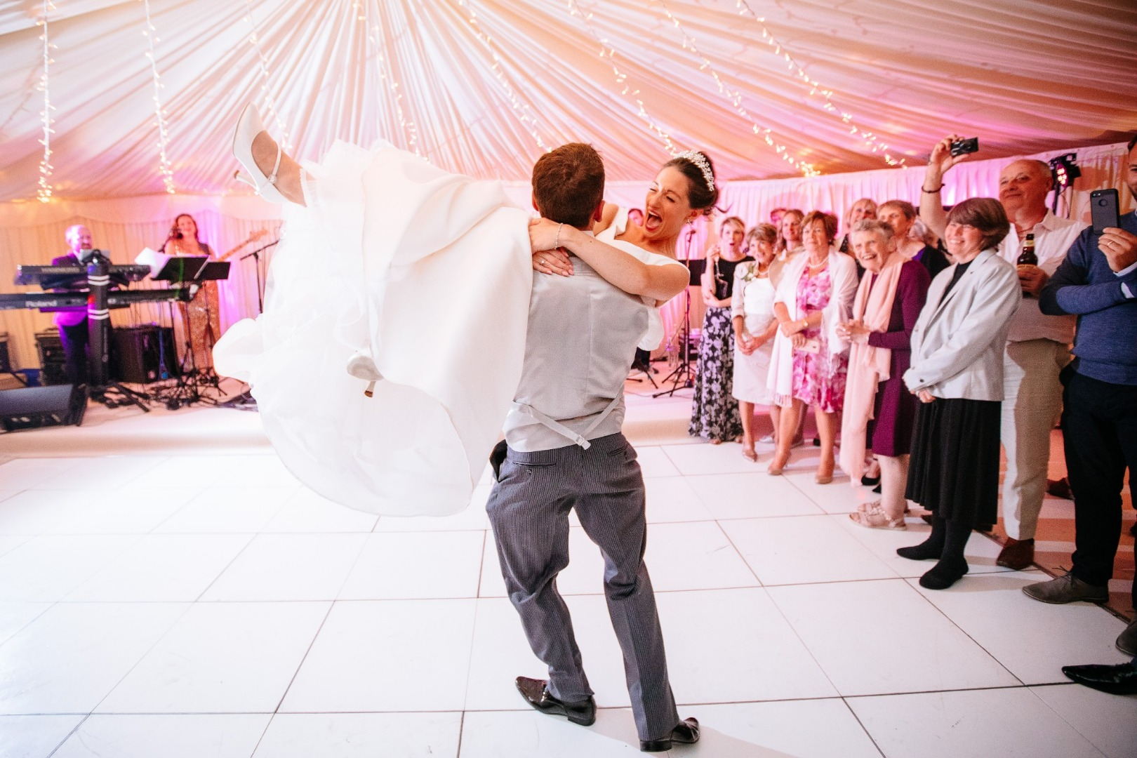 Bride and groom dancing first dance to live band. Photo by Sarah Legge.