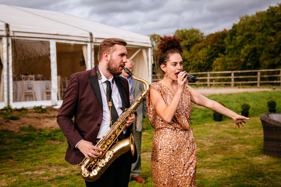 Roaming musicians performing at Surrey summer wedding. Photo by Sarah Legge