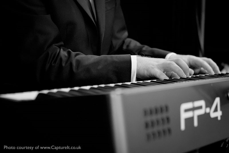 Cocktail pianist Mike Paul-Smith performing at Anthony and Becky's Wedding Reception at Pinewood Studios, Buckinghamshire.  Photo courtesy of Capture It.