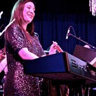 Keyboardist Amelia Forster performing at A Very Down for the Count Christmas, Winslow Public Hall, Buckinghamshire. Photo courtesy of Ellie Jones.