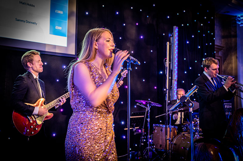 Down for the Count Soul Band performing live music at a charity ball in Brighton
