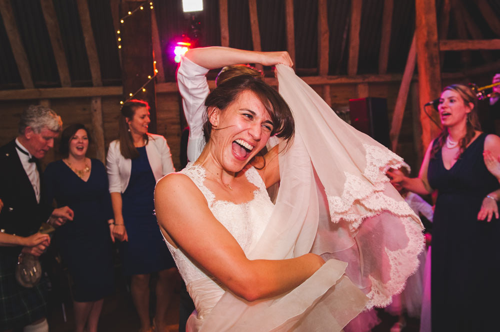 Bride dancing to live music at an Oxfordshire wedding reception