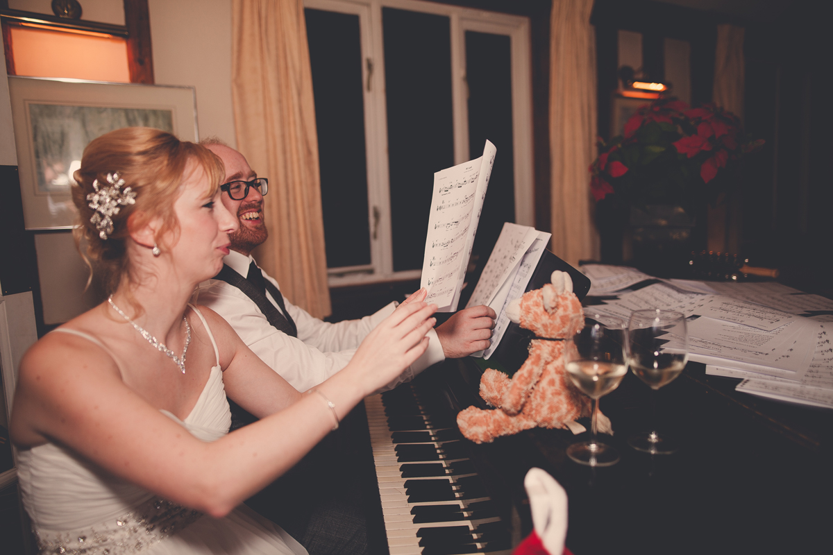 Christmas carols around the piano at Mike's December wedding