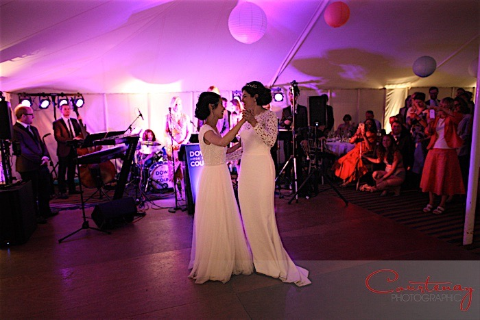 First dance with brides at marquee wedding reception in Dorset with live music from Down for the Count