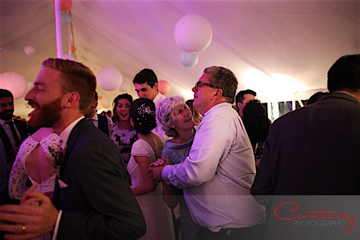 Wedding guests dancing to live music in a marquee with live music from Down for the Count