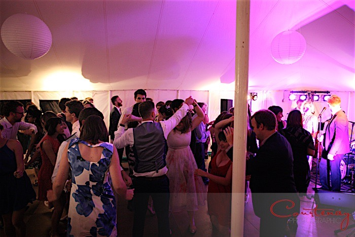 Busy dancefloor at Dorset wedding in marquee with live music from Down for the Count