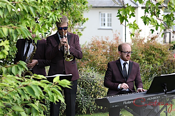 Jazz standards quartet performing live swing music and countryside marquee wedding reception