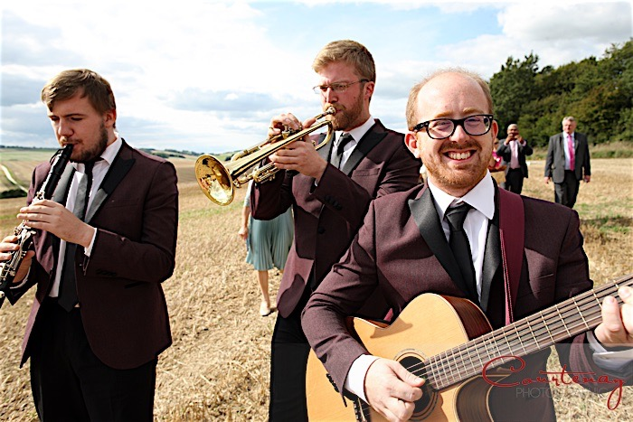 Walkabout acoustic Dixieland band performing at wedding ceremony