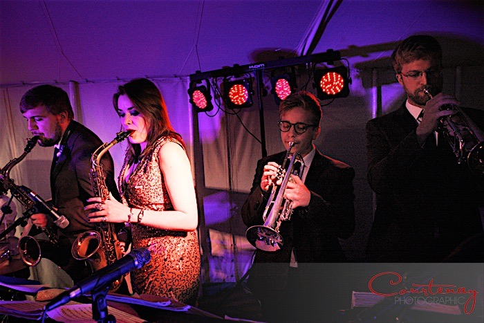 Horn section at marquee wedding - trumpet and saxophone, live band Down for the Count